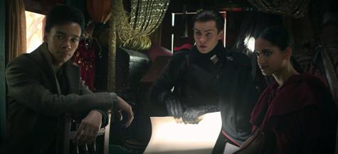 "Kaz, Jasper & Inej (Kit Young, Freddy Carter, and Amita Suman) in ""Shadow and Bone"". (pic Mairzee Almas/Netflix)"