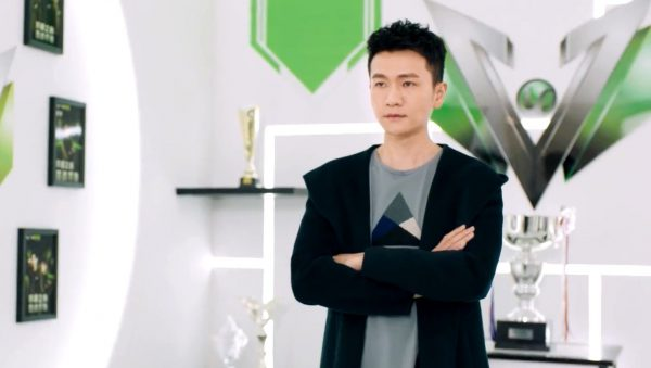 Wang Jiexi poses for photo's at his office