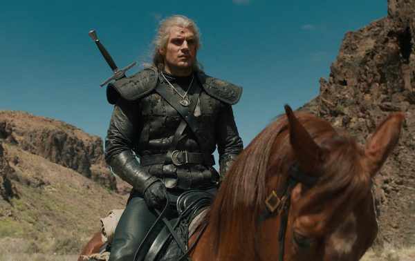 Geralt played by Henry Cavill) on horseback